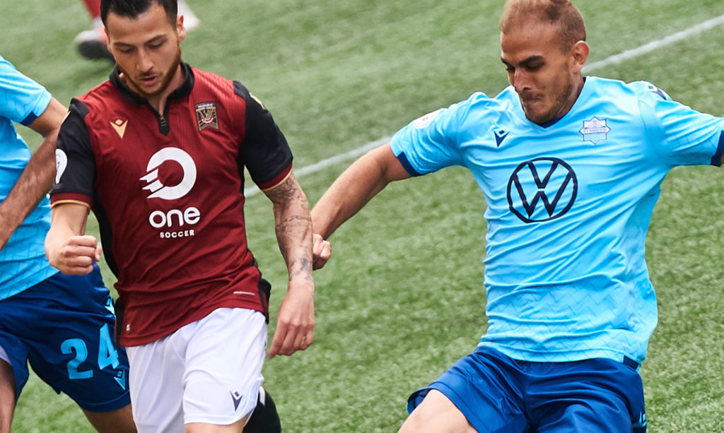 HFX's Mathew Arnone (R) and Valour's Marco Bustos (L) battle for the ball. (Photo: Valour FC).