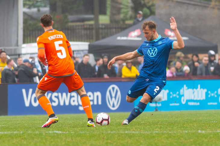 Peter Schaale firing a long range pass out from the back against Forge FC in the club's home opener last May. Photo: Trevor MacMillan.