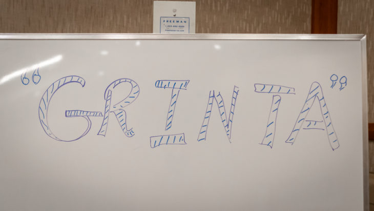The word 'grinta' was written on the team's squad room whiteboard by Head Coach Stephen Hart.
